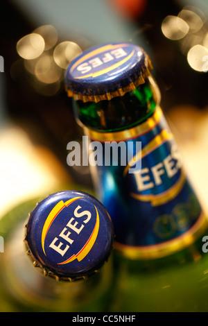 Bottles of the Turkish Efes Pilsen beer - Stock Photo
