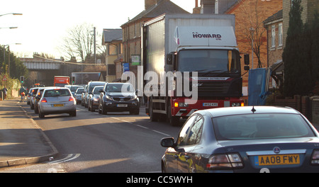 A delivery lorry parked awkwardly on a busy narrow road causes traffic congestion in Huntingdon, Cambridgeshire. - Stock Photo
