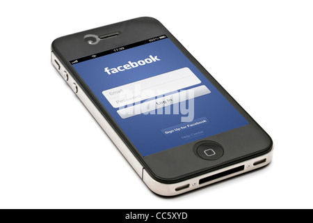 Facebook login displayed on an iPhone screen - Stock Photo