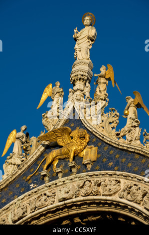 St Mark & Angels Carved Statues on top of the Basilica di San Marco, Venice - Stock Photo