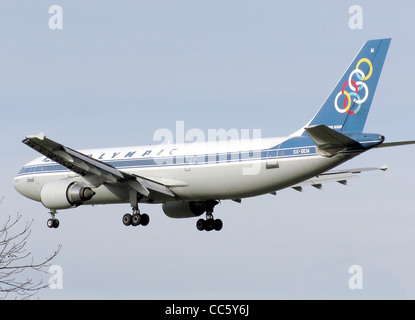 Olympic Airlines Airbus A300B4-600R landing at London Heathrow Airport, England. - Stock Photo