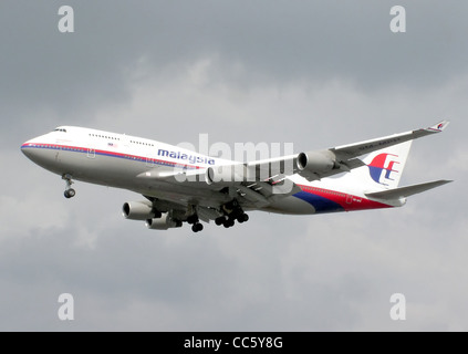 Malaysia Airlines Boeing 747-400 (9M-MPH)landing at London Heathrow Airport, England. - Stock Photo