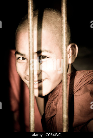 Portrait of a young Buddhist monk in Bagaya Kyaung at the ancient city of Ava near Mandalay, Burma, South East Asia. - Stock Photo