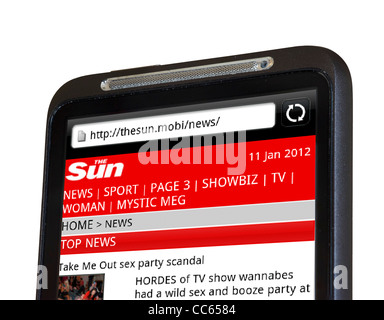 Browsing The Sun online newspaper site on an HTC smartphone - Stock Photo