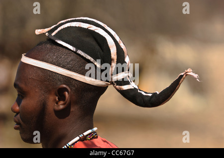 Portrait of Himba man with traditional hairstyle. Kaokoland, Northern Namibia.