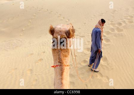 Camel riding in the Thar Desert, Jaisalmer, Rajasthan, India - Stock Photo