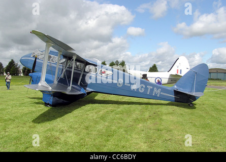de Havilland DH89a Dragon Rapide 6 (UK registration G-AGTM, year of build 1944) at Kemble Airfield, Gloucestershire, - Stock Photo