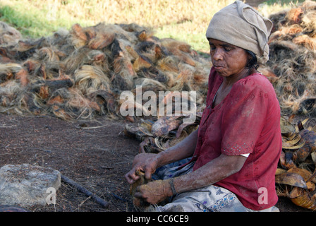 Old women working hard in Coir Industry (Small scale coconut Coir Industry) at Kerala,India - Stock Photo