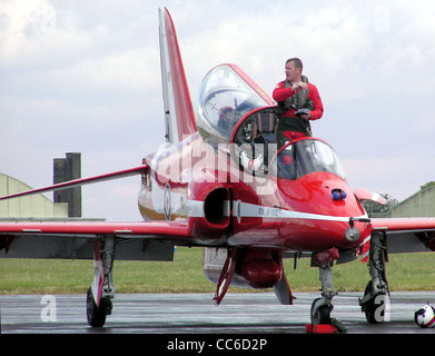 A Red Arrows pilot exits his Hawk aircraft at the end of the display - Stock Photo