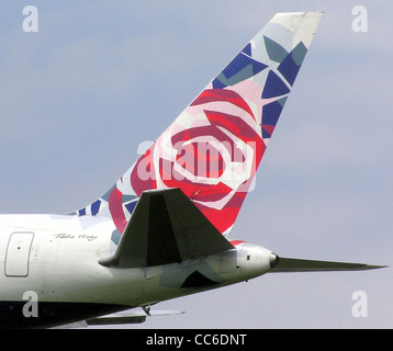 """British Airways tail colour scheme """"Chelsea Rose"""" on a Boeing 767-300 (G-BNWB) approaching London (Heathrow) Airport. - Stock Photo"""