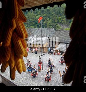 Miao women dancing, Nanhua Miao Village, Qiandongnan Miao and Dong Autonomous Prefecture, Guizhou , China - Stock Photo