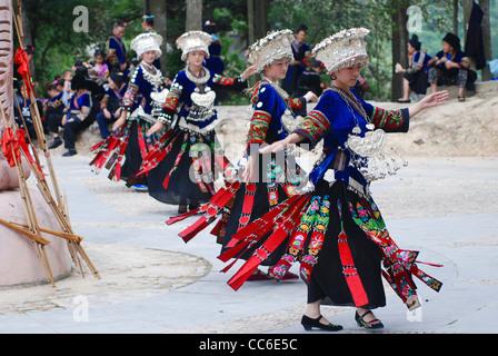 Miao women performing traditional dance, Nanhua Miao Village, Qiandongnan Miao and Dong Autonomous Prefecture, Guizhou, - Stock Photo