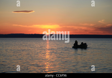 Kanas Lake at sunset, Altay Prefecture, Xinjiang, China - Stock Photo