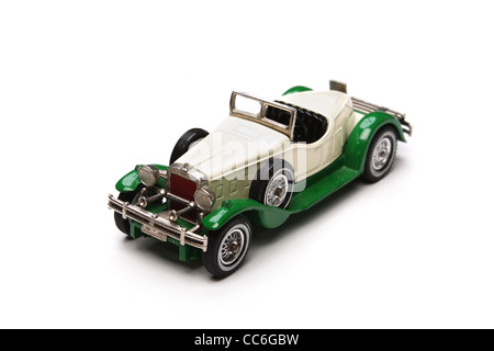 Old toy car close-up isolated on a white background. Shallow DOF. - Stock Photo