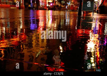 Rainy reflections on Wardour Street, Chinatown, London, UK - Stock Photo
