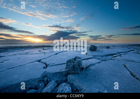 Sunset over the limestone pavement of The Burren, Fanore, County Clare, Ireland. - Stock Photo