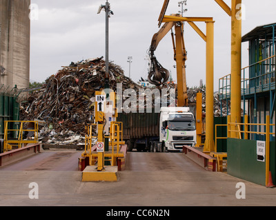 Lorry unloading scrap metal at the docks, Gloucester and Sharpness canal, UK - Stock Photo