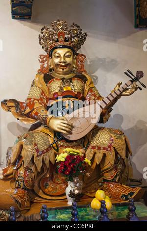 China, Hong Kong, Lantau, Interior of Po Lin Monastery, Temple Guardian Statue - Stock Photo