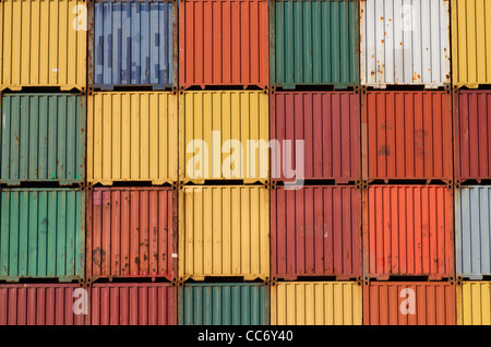 Lots of colourful ship cargo containers stacked up in a port. - Stock Photo