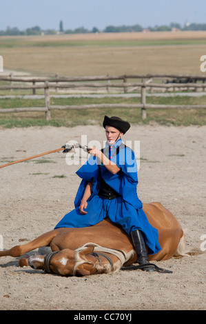 Hungary, Kalocsa. Traditional Hungarian ranch & cowboy show. Horse show trick. - Stock Photo