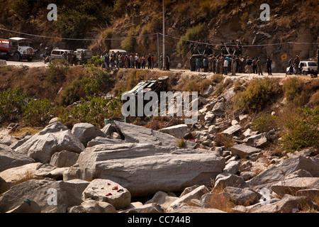 India, Arunachal Pradesh, Tenga Cantonment, army truck on side on rocks having crashed off road to Bomdila - Stock Photo