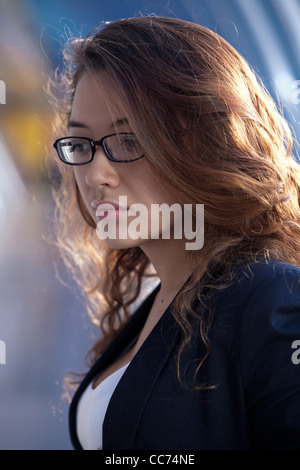 beautiful red-haired woman in glasses thought - Stock Photo