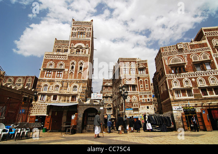 Yemen, Sana'a, Sanaa, in the Old town of Sanaa, a square near Bab-al-Yemen or Yemen Gate, with ancient skyscrapers - Stock Photo