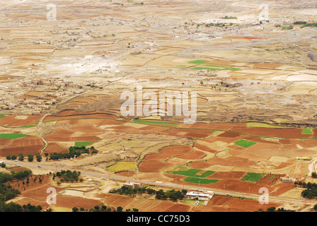 Yemen, Kowkaban, aerial view of farm fields, fallows, patchwork landscape with mountains in the background - Stock Photo