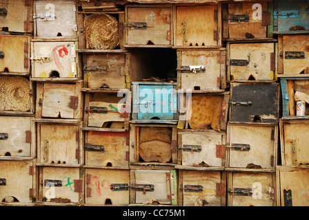 Yemen, inland, detail of weathered wooden boxes with blue colored box in between - Stock Photo