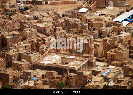 Yemen, Kowkaban, elevated view of congested residential houses trees in background - Stock Photo