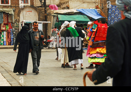 Yemen, Sanaa, view of people walking on street in market - Stock Photo