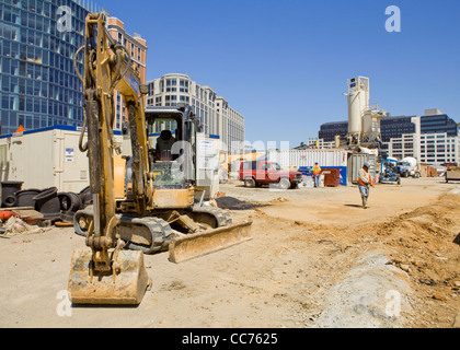 A crawler track backhoe parked in an urban construction site - USA - Stock Photo