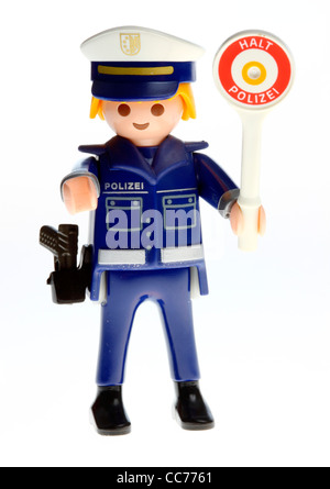 Stop police. Playmobil figure, toy. Police control, speed control, symbol picture. - Stock Photo