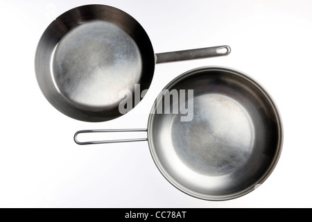 Compilation of various kitchen utensils, kitchen tools. Metal pans. - Stock Photo
