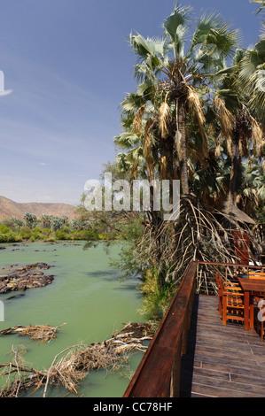 Kunene river near the Epupa Falls, seen from a terrace of a lodge.  Kaokoland, Namibia. - Stock Photo