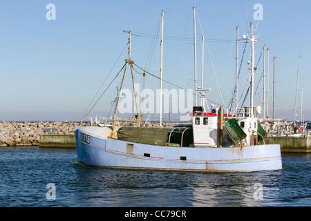 Fishing Boat, leaving the harbour, Gilleleje, Sjaelland, Denmark - Stock Photo