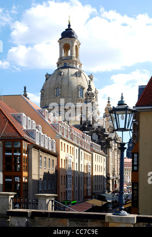 Look at the rebuilt Frauenkirche from Bruehl's terrace over the houses in the coining lane on the New market in - Stock Photo