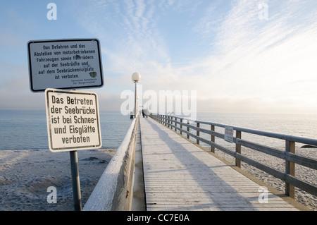 Icy pier in winter, Haffkrug, Luebeck Bay, Baltic Sea, Schleswig-Holstein, Germany, Europe - Stock Photo