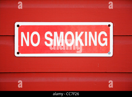 no smoking sign mounted on wall - Stock Photo