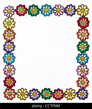 Embroidery iron on patches of Multicoloured smiley face flowers in a frame on a white background - Stock Photo