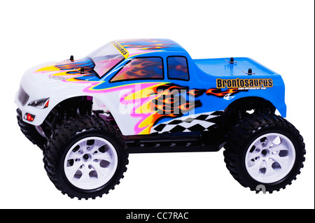A radio controlled Brontosaurus off road buggy car on a white background - Stock Photo