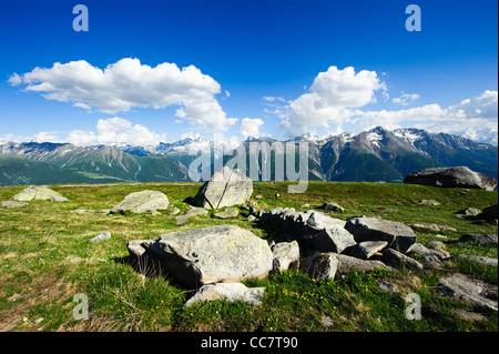 Mountain panorama with clouds and blue sky from Fiescheralp, Wallis, Switzerland - Stock Photo