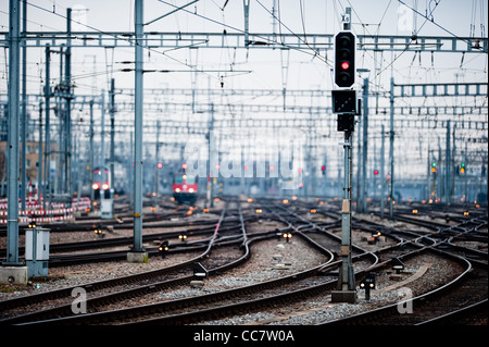 Railway lines at Zuerich main station vanishing into distant blur (low dof), Zuerich Switzerland - Stock Photo