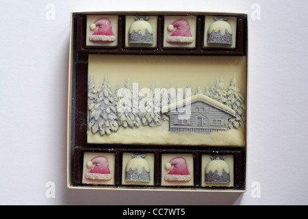 choconchoc luxury white Belgian chocolate decorated with Christmas items and edible glitter in box homemade decorated - Stock Photo