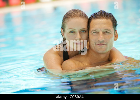 Portrait of Couple in Pool, Palm Beach Gardens, Florida, USA - Stock Photo