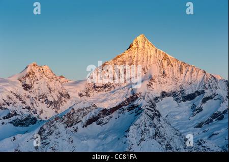 Weisshorn mountain peak at sunrise, view from Gornergrat, Zermatt, Switzerland - Stock Photo