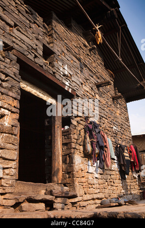 India, Arunachal Pradesh, Dirang Dzong, entrance to old stone built house within fortified historic village - Stock Photo