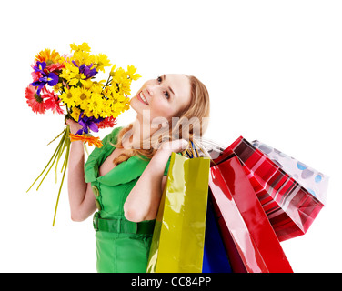 Young woman with shopping bag and flowers. - Stock Photo