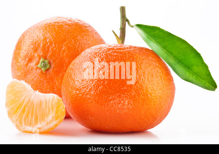 Tangerines with leaves on white background. - Stock Photo