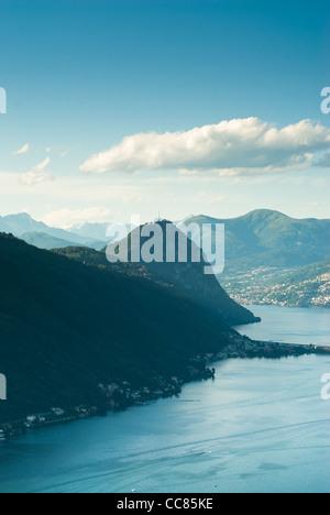 Monte San Salvatore and lake of Lugano. View from Serpiano, Tessin, Switzerland. - Stock Photo